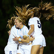 UNC forward Annie Kingman (7) celebrates with teammates Summer Green (6) and Sarah Ashley Firstenberg (54) after Kingman scored a a goal in the second half against Florida State on October 23rd, 2014 at Fetzer Field in Chapel Hill, N.C. Kingman's goal was the only Tar Heel goal in the 1-1 tie with the Seminoles.