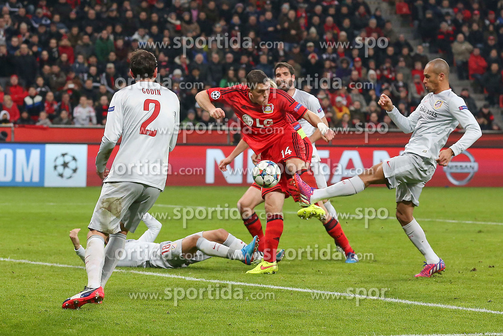 25.02.2015, BayArena, Leverkusen, GER, UEFA EL, Bayer 04 Leverkusen vs Atletico Madrid, 1. Runde, R&uuml;ckspiel, im Bild Miranda (Atletico Madrid #23) klaert vor dem Einschussbereiten Kyriakos Papadopoulos (Bayer 04 Leverkusen #14) // during the UEFA Europa League 1st Round, 2nd Leg match between Bayer 04 Leverkusen and Atletico Madrid at the BayArena in Leverkusen, Germany on 2015/02/25. EXPA Pictures &copy; 2015, PhotoCredit: EXPA/ Eibner-Pressefoto/ Schueler<br /> <br /> *****ATTENTION - OUT of GER*****