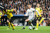 Real Madrid's Cristiano Ronaldo and Borussia Dortmund Sokratis Papastathopoulos and Julian Weigl during the UEFA Champions League match between Real Madrid and Borussia Dortmund at Santiago Bernabeu Stadium in Madrid, Spain. December 07, 2016. (ALTERPHOTOS/BorjaB.Hojas)