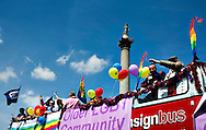 People cheer as they pass by Trafalgar Square during the annual Gay Pride parade in London, Britain, 29 June 2013. BOGDAN MARAN / BPA