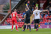 Luke Summerfield receives a caution during the Capital One Cup match between York City and Bradford City at Bootham Crescent, York, England on 11 August 2015. Photo by Simon Davies.