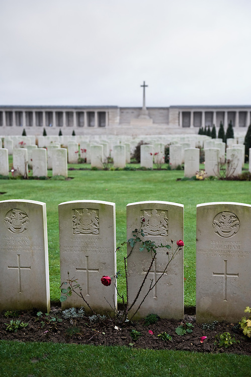 "The Pozières British Cemetery is enclosed by the Pozières Memorial to the Missing. The cemetery contains the original burials of 1916, 1917 and 1918 carried out by fighting units. There are in total 2,760 Commonwealth servicemen buried here. The memorial  commemorates over 14,000 casualties of the British Army that died on the Somme at the time of the German ""Spring Offensive""  between March and August 1918 and have no known grave. The cemetery and memorial were designed by William Harrison Cowlishaw and it was unveiled in August 1930"