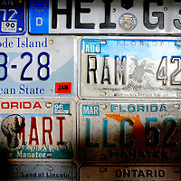 ANNA MARIA ISLAND, FL -- July 9, 2009 -- License plates donated from customers hang underneath the bar at Duffy's Tavern on Anna Maria Island in Manatee County, Fla., on Thursday, July 9, 2009.  (Chip Litherland for The New York Times)