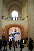 Visitors wander through the corridors of The Louvre Museum in Paris, France.