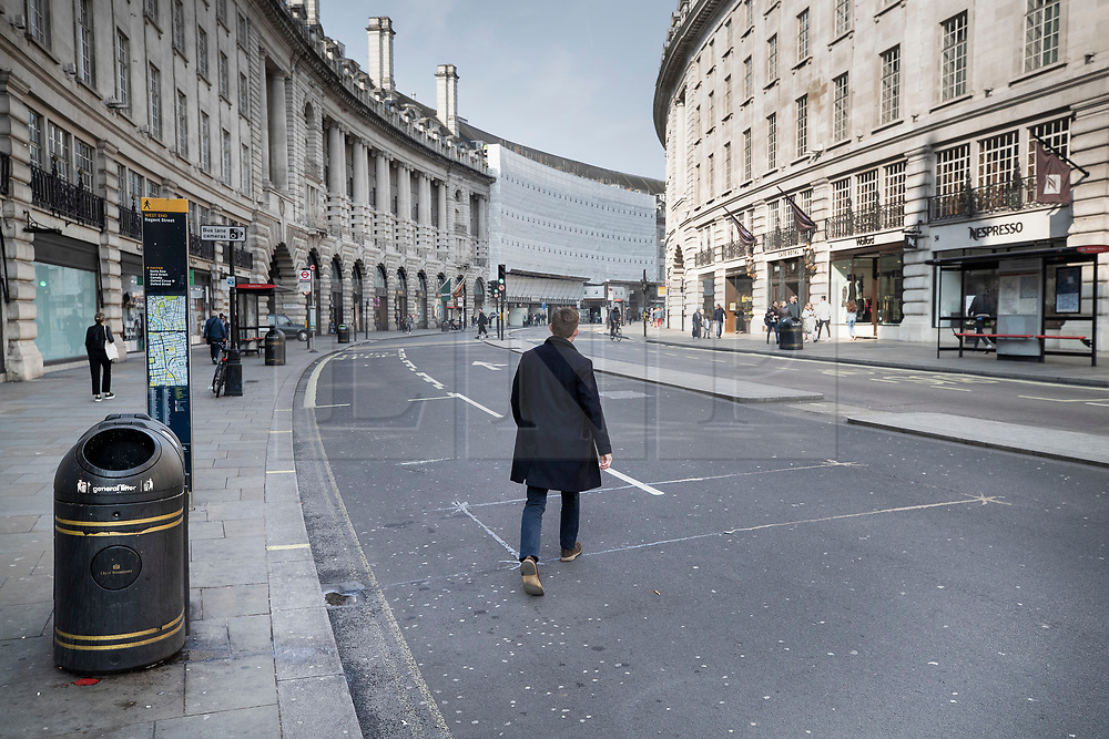 © Licensed to London News Pictures. 17/04/2019. London, UK. Regent Street is empty of traffic at 10am as XR (Extinction Rebellion) climate change protest group continue their demonstrations and blockades in the capital. XR actions are still blocking traffic at various location across the capital despite nearly 300 arrests and are expected to disrupt underground travel today. Photo credit: Peter Macdiarmid/LNP