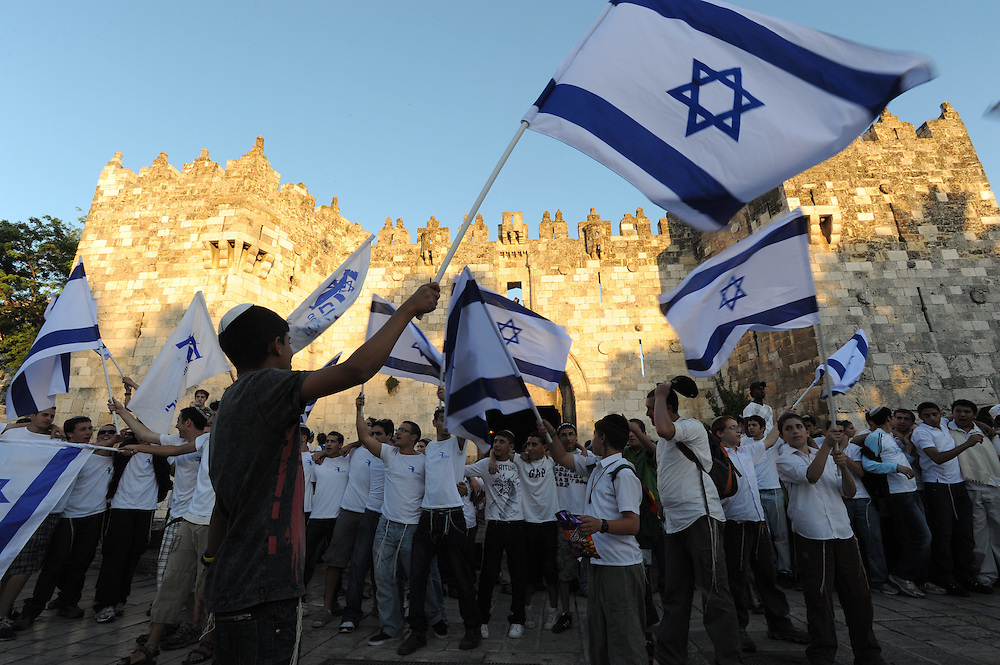 JERUSALEM, ISRAEL - MAY 12, 2010: Israeli youth wave Israeli flags and dance near Damascuss  Gate of Jerusalem's Old city during a march celebrating Jerusalem Day, Thursday, May 12, 2010. Thousands took part in Jerusalem Day celebrations in the capital, marked the 43nd anniversary of its capture of Arab east Jerusalem in the Six Day War of 1967. Photo by GILI YAARI/NEWS-PICTURES