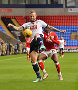Bolton Defender, David Wheater clears the danger from an incoming Bristol city forward, Kieran Agard during the Sky Bet Championship match between Bolton Wanderers and Bristol City at the Macron Stadium, Bolton, England on 7 November 2015. Photo by Mark Pollitt.