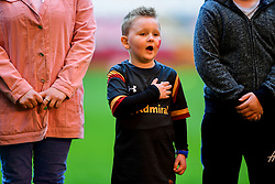 A young fan with a Dragon and Cymru painted on his face sings the national anthem on the pitch before the training session - Photo mandatory by-line: Ryan Hiscott/JMP - 29/10/2018 - RUGBY - Principality Stadium - Cardiff, Wales - Autumn Series - Wales Rugby Open Training Session