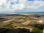 Nederland, Noord-Holland, Texel, 16-04-2012; Polder Eijerland gezien naar De Slufter en de Noordzee.Polder with farmhouses at the isle of Texel. Northsea in the back..luchtfoto (toeslag), aerial photo (additional fee required);.copyright foto/photo Siebe Swart