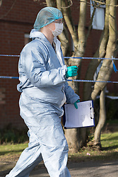 © Licensed to London News Pictures. 16/02/2018. London, UK. Police forensic officer outside Garenne Court in Warren Road, Waltham Forest. A murder investigation has been launched after a man was found dead suffering from multiple injuries yesterday, 15th February. A 38 year old woman and a 63 year old man were arrested on suspicion of murder in the early hours of this morning.  Photo credit: Vickie Flores/LNP