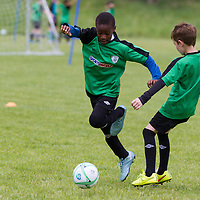 John Akiebey dribbles the ball during the Avenue Utd Summer Soccer Camp
