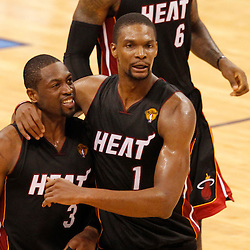 Jun 14, 2012; Oklahoma City, OK, USA; Miami Heat shooting guard Dwyane Wade (3) and Miami Heat power forward Chris Bosh (1) celebrate during the fourth quarter of game two in the 2012 NBA Finals against the Oklahoma City Thunderat Chesapeake Energy Arena. Miami won 100-96. Mandatory Credit: Derick E. Hingle-US PRESSWIRE