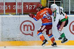 John Hughes (HDD Tilia Olimpija, #72) vs Marjan Manfreda (HK Acroni Jesenice, #18) during ice-hockey match between HK Acroni Jesenice and HDD Tilia Olimpija in fourth game of Final at Slovenian National League, on April 8, 2011 at Dvorana Podmezaklja, Jesenice, Slovenia. (Photo By Matic Klansek Velej / Sportida.com)