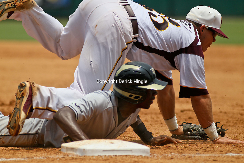 June 04, 2011; Tallahassee, FL, USA; UCF Knights short stop Darnell Sweeney dives back to first base as the ball gets past Bethune-Cookman Wildcats first baseman Ryan Durrence (35) during the third inning of the Tallahassee regional of the 2011 NCAA baseball tournament at Dick Howser Stadium. Mandatory Credit: Derick E. Hingle