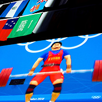 Gold Medal winner Lin Qingfeng competes in the 69 kg weightlifting competition during the 2012 London Summer Olympics.