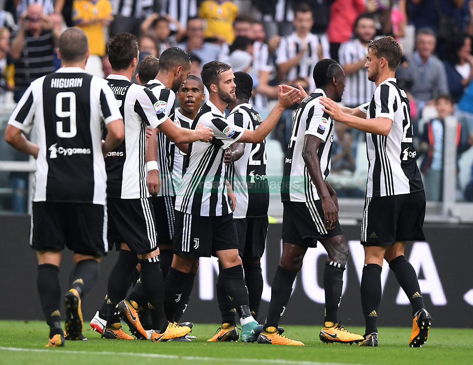 TURIN, Sept. 10, 2017  Players of Juventus celebrate a goal during the Italian Serie A soccer match between Juventus and Chievo, in Turin, Italy, Sept. 9, 2017. Juventus won 3-0. (Credit Image: © Alberto Lingria/Xinhua via ZUMA Wire)