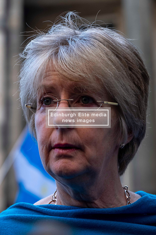 Pictured: Lawyer for the protestors Elaine Motion passed on the news to the waiting media<br />