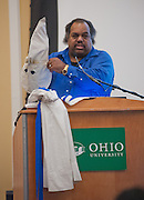 "Daryl Davis holds up a robe used by a Ku Klux Klan national official, Roger Kelly, in Baker Ballroom, Thursday, February 21, 2013. Davis explained the relationship that lead to Kelly gaving Davis his robe after quitting the KKK years after they started forming a friendship. Davis is the author of ""Klan-Destine Relationships,"" a nonfiction account of his journeys while infiltrating the minds of KKK members."