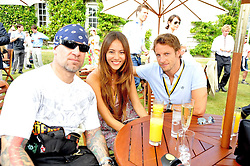 Left to right, JESSE JAMES husband of Sandra Bullock,  JESSICA MICHIBATA and JENSON BUTTON at a luncheon hosted by Cartier for their sponsorship of the Style et Luxe part of the Goodwood Festival of Speed at Goodwood House, West Sussex on 5th July 2009.