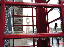 (c) London News Pictures. 10.12.2010. A famous red London photne box stands smashed in Parliament Square. The clean-up operation in Westminster following last night's student demonstration. Picture credit should read: Brian Duckett/London News Pictures