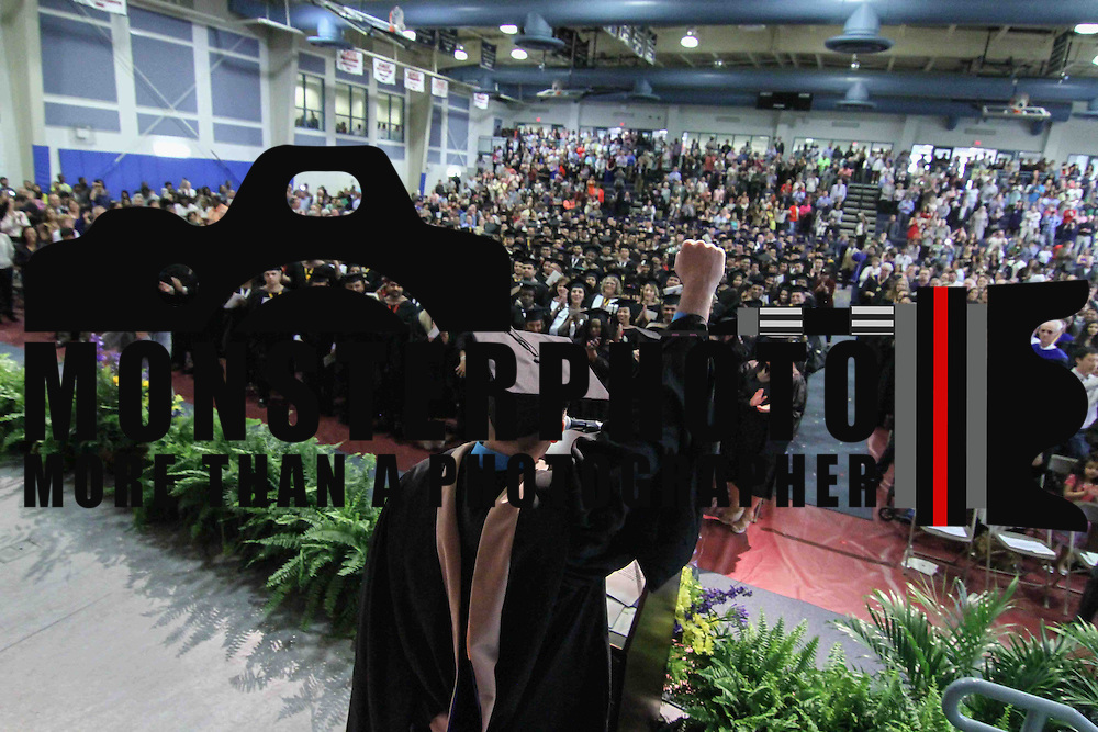 Goldey-Beacom College MBA 2015 graduate Matthew I. Bik, CENTER, celebrates with students during Goldey-Beacom commencement exercise Friday, May 1, 2015, at Joseph West Jones College Center on the campus of Goldey-Beacom College in Wilmington Delaware.