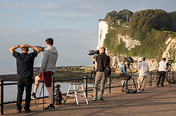 © Licensed to London News Pictures. 04/08/2019. Dover, UK. Photographers and television crews await the arrival of French inventor Franky Zapata at St Margarets Bay near Dover as he crosses the English Channel on his jet-powered hoverboard. He is hoping to make the 35km crossing with a refueling stop mid-channel to reach the English coast after setting off at 6am French time. Photo credit: Peter Macdiarmid/LNP