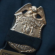 Law enforcement officer wearing black ribbon on his badge for fallen or killed NYPD Officer.