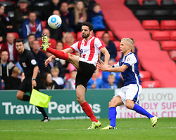 Lincoln City's Sam Habergham clears under pressure from Barrow's Lindon Meikle<br /> <br /> Picture: Chris Vaughan/Chris Vaughan Photography<br /> <br /> Football - Vanarama National League - Lincoln City Vs Barrow - Saturday 17th September 2016 - Sincil Bank - Lincoln<br /> <br /> Copyright © 2016 Chris Vaughan Photography. All rights reserved. Unit 11, Churchill Business Park, Bracebridge Heath, Lincoln, LN4 2FF - Telephone: 07764170783 - info@chrisvaughanphotography.co.uk - www.chrisvaughanphotography.co.uk
