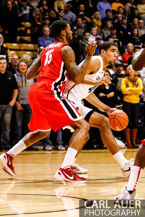 December 28th, 2013:  Colorado Buffaloes sophomore forward Josh Scott (40) posts up against Georgia Bulldogs senior forward Donte' Williams (15) in the first half of the NCAA Basketball game between the Georgia Bulldogs and the University of Colorado Buffaloes at the Coors Events Center in Boulder, Colorado