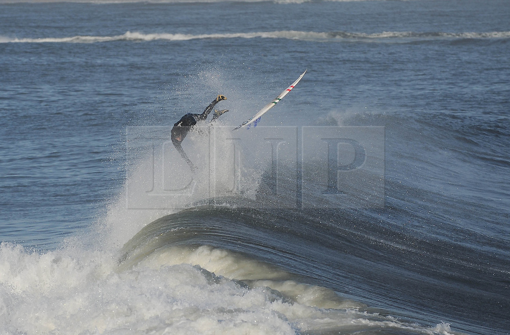 © Licensed to London News Pictures. 27/03/2014<br /> <br /> Cleveland, England<br /> <br /> A surfer on the north east coast of England comes off the back of a wave as he enjoys an early morning surf.<br /> <br /> Photo credit : Ian Forsyth/LNP