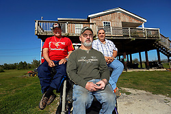 04 March 2016. Isle de Jean Charles, Louisiana.<br /> Vanishing land. First climate refugees in the USA. Isle de Jean Charles Band of Biloxi-Chitimacha Indians.<br /> L/R; Chief Albert Naquin, Chris Brunet of the tribal council and deputy Chief Boyo Billiot. The tribe has recently been awarded $52 million to resettle on higher ground as more and more of their land is consumed from erosion by the Gulf of Mexico.<br /> Photo©; Charlie Varley/varleypix.com