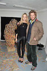FLORENCE BRUDENELL-BRUCE and her brother HENRY BRUDENELL-BRUCE at a Contemporary Art evening hosted by NUBA Art Ltd entitles 'It's a Material World' held at London West Bank Gallery, 133-137 Westbourne Grove, London W11 on 1st December 2011.