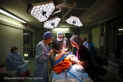 Plastic Surgeon Team Leader Conrad Pienaar prepares to repair the UCL of patient  027, Siyabonga Gwebu, 17 Months old, Male, UCL, before. Rob Ferreira hospital during Operation Smile South Africa&rsquo;s 2015 mission to Mbombela. South Africa.<br /> <br /> (Operation Smile Photo - Zute Lightfoot)