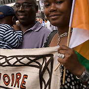 September 11 Rally against racism and Islam phobia to stop the attacks on the Muslim community.  African Muslim family holding sign  from (Cote D' Ivoire ) the Ivory Cost at rally.