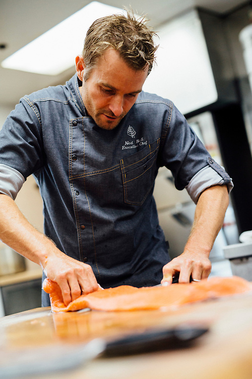 Executive Chef at Yew Seafood + Bar, Ned Bell, prepares a salmon dish. Vancouver, British Columbia, Canada.