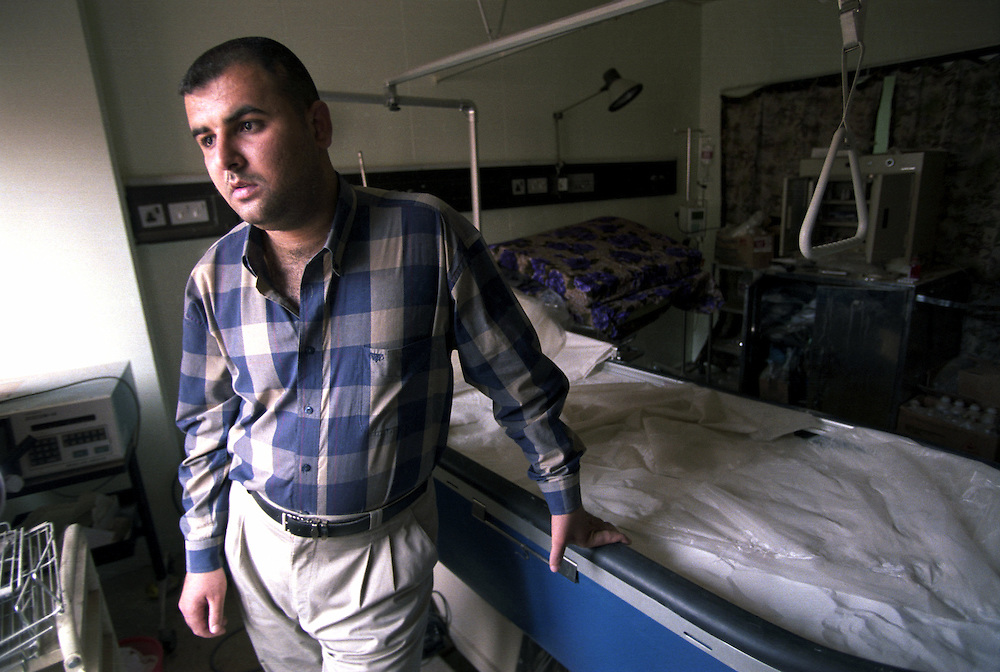 Dr. Anmar Uday, who cared for Jessica Lynch while she was held at the Nasiriya General Hospital, next to the special bed of fine sand designed for patients with bed sores where Jessica was sleeping when US forces rescued her from the hospital..Nasiriya, Iraq. 25 May 2003..Photo © J.B. Russell