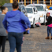 Thomas Wells   BUY AT PHOTOS.DJOURNAL.COM<br /> Mahari Atkinson, 6, tells others to hurry up so the motorcade to the annual Dr. Martin King service can leave and make it's way to St. Paul Christian Life Center on Front Street Monday.
