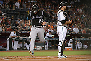 Apr 28, 2017; Phoenix, AZ, USA; Colorado Rockies infielder Nolan Arenado (28) scores in the first inning behind Arizona Diamondbacks catcher Chris Iannetta (8) at Chase Field. Mandatory Credit: Jennifer Stewart-USA TODAY Sports