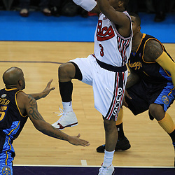 28 January 2009: New Orleans Hornets guard Chris Paul (3) drives to the basket during a 94-81 win by the New Orleans Hornets over the Denver Nuggets at the New Orleans Arena in New Orleans, LA. The Hornets wore special throwback uniforms of the former ABA franchise the New Orleans Buccaneers for the game as they honored the Bucs franchise as a part of the NBA's Hardwood Classics series. .