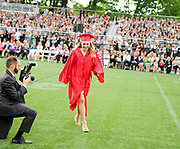 Olivia Gieger walks up to receive one of the Class of 2017 senior cups during the 148th Graduation exercises at Wellesley High School on June, 2, 2017.   [Wicked Local Photo/James Jesson]
