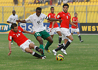 Photo: Steve Bond/Richard Lane Photography.<br />Egypt v Zambia. Africa Cup of Nations. 30/01/2008. Sayed Moawad (L) gets a tackle in on Christopher Katongo (C)