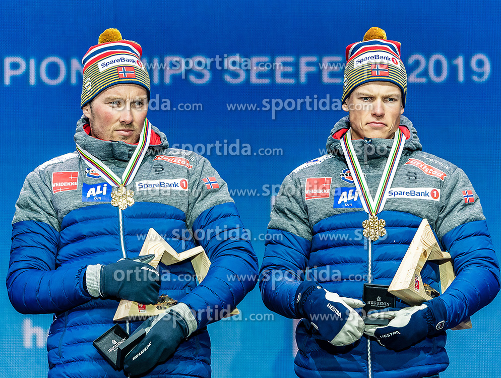 24.02.2019, Medal Plaza, Seefeld, AUT, FIS Weltmeisterschaften Ski Nordisch, Seefeld 2019, Langlauf, Herren, Teambewerb, Siegerehrung, im Bild Goldmedaillengewinner Johannes Hoesflot Klaebo (NOR), Emil Iversen (NOR) // World champion and Gold medalist Johannes Hoesflot Klaebo Emil Iversen of Norway during the winner ceremony for the men's cross country team competition of FIS Nordic Ski World Championships 2019 at the Medal Plaza in Seefeld, Austria on 2019/02/24. EXPA Pictures © 2019, PhotoCredit: EXPA/ Stefan Adelsberger