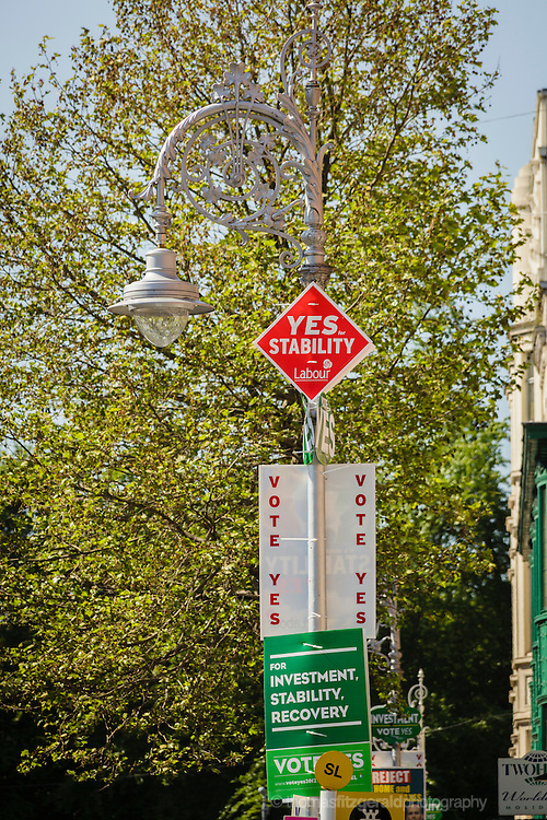 An ornate Dublin street Light is covered in posters for ther upcoming fiscal treaty referendum