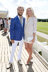 RICK PARFITT JNR & RACHEL GRETTON at the Audi Polo Challenge 2013 at Coworth Park Polo Club, Berkshire on 3rd August 2013.