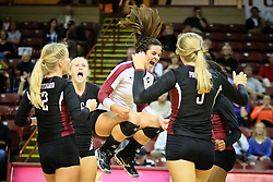 Marla Sagatelian, middle, celebrates a win of the first set against Ashley Hall during the SCISA volleyball championship Monday, Oct. 22, 2012 in Charleston at the College of Charleston TD Arena. Paul Zoeller/Special to the Post and Courier