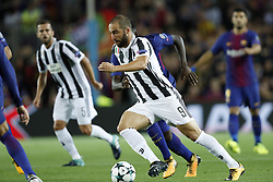 (L-R) Gonzalo Higuain of Juventus FC, Samuel Umtiti of FC Barcelona during the UEFA Champions League group D match between FC Barcelona and Juventus FC  on September 12, 2017  at the Camp Nou stadium in Barcelona, Spain.