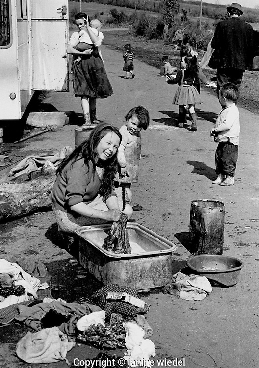 Irish Tinker Traveller family washing clothes in road at camp site in Southern Ireland in the 1970's.