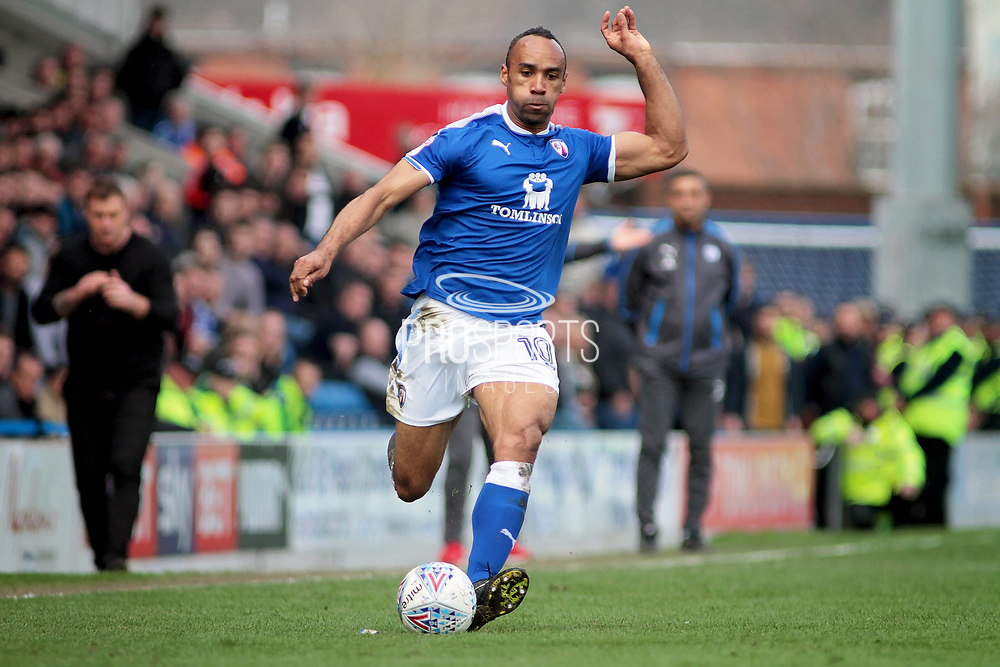 Chesterfield forward Chris O'Grady (10) gets in a cross during the EFL Sky Bet League 2 match between Chesterfield and Mansfield Town at the Proact stadium, Chesterfield, England on 14 A pril 2018. Picture by Nigel Cole.