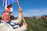 20150614 Ligny Belgium. The Battle of Ligny (16 June 1815) was the last victory of the military career of Napoleon I.Today it was re-enacted by 1500 people just a few days before the 200th birth day of Napoleon's final loss at Waterloo.An Napoleonic fan screams with imperialistic flag at the side of the battle field.