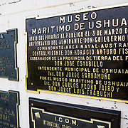 Plaques identifying the entrance of the Maritime Museum of Ushuaia. The museum consists of several wings devoted to maritime history, Antarctic exploration, an art gallery, and an historic prison.